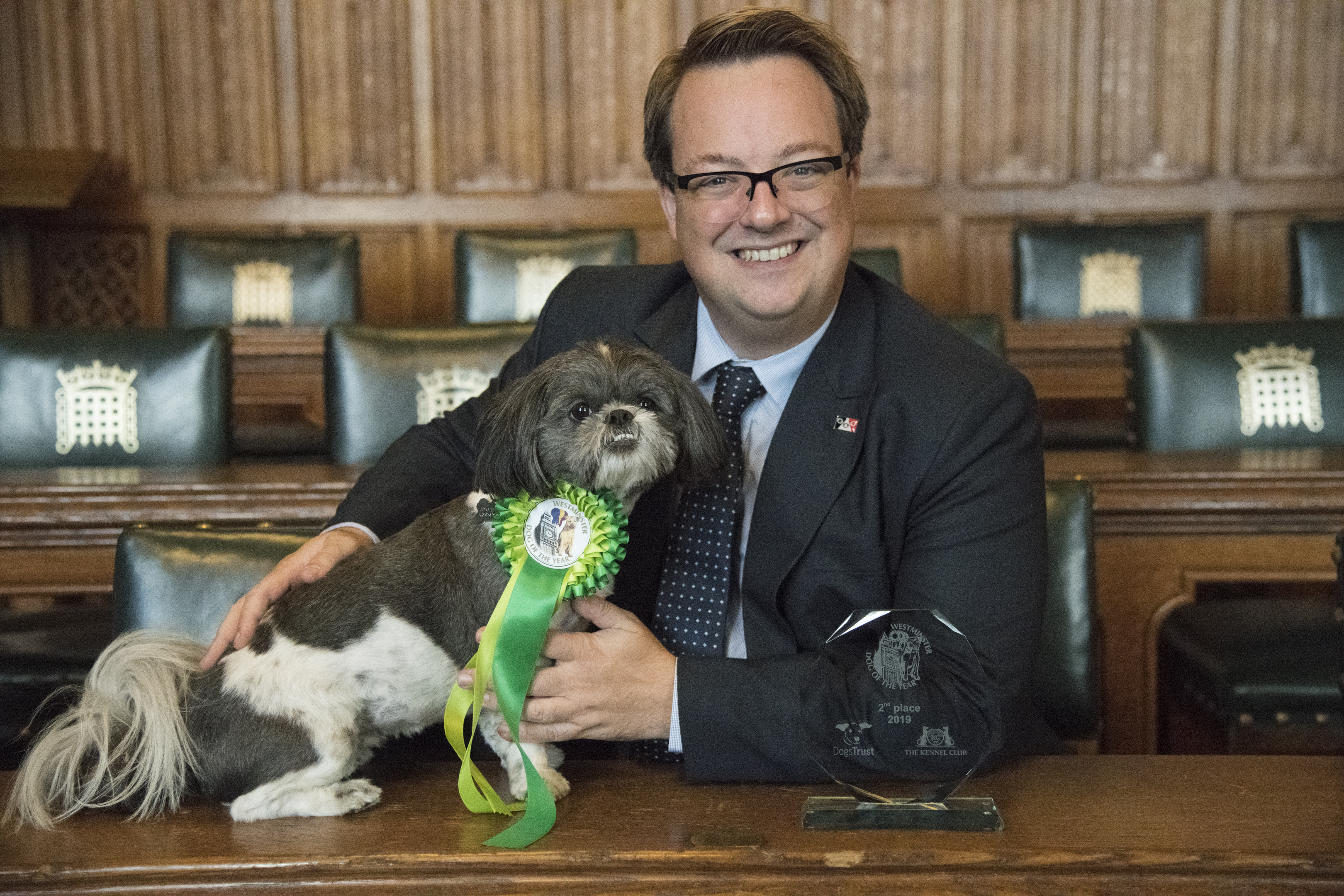 Mike and Bella accept Bella's second-place prizes in the Westminster Dog of the Year competition
