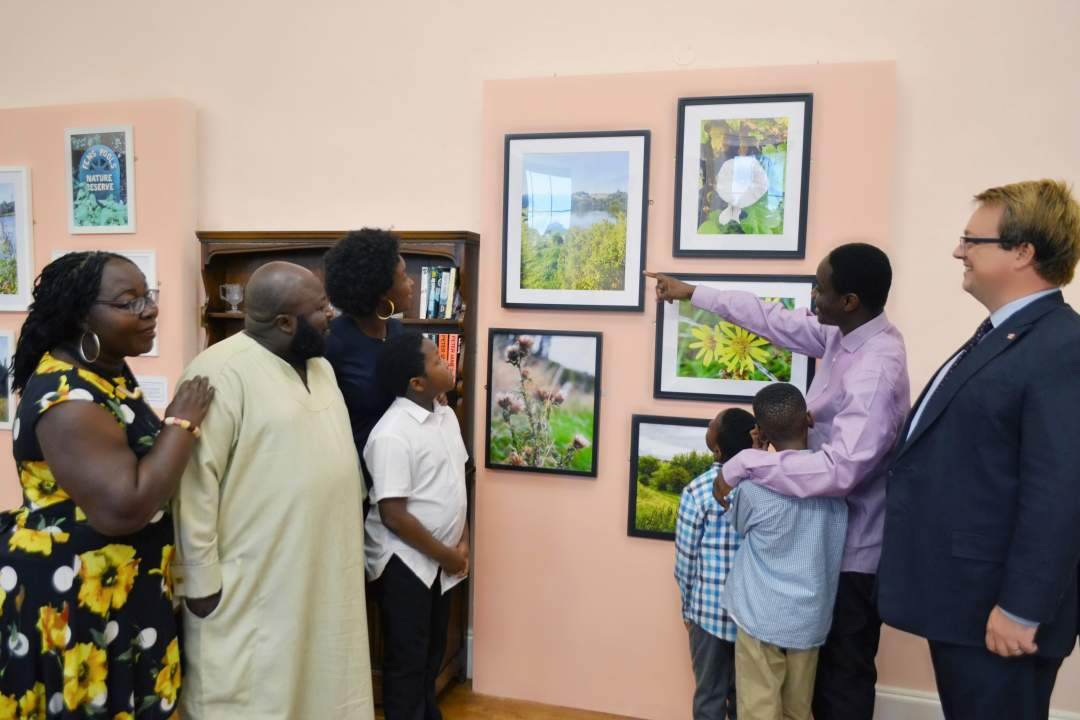 Alan showing Mike his artwork display at Himley Hall
