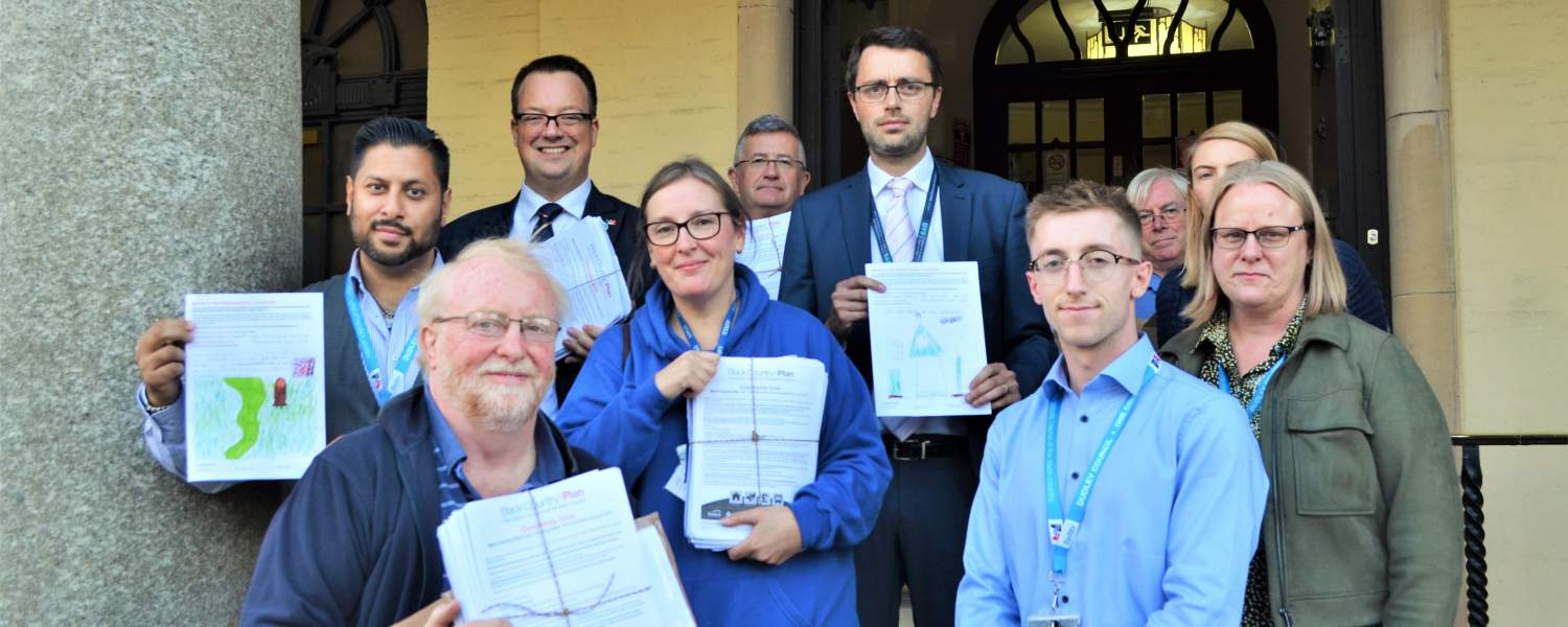 Mike Wood MP with Cllrs and Wall Heath As One Campaigners handing over consultation responses at Dudley Council House